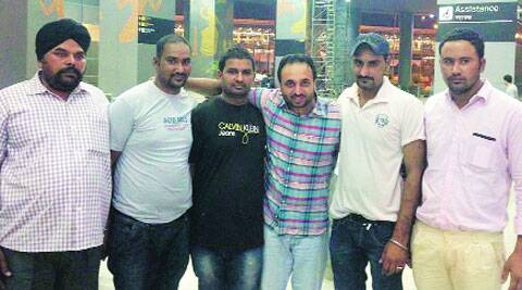 Bhagwant Mann (third from right) with the youths who came back from Iraq.  (Source: Express)