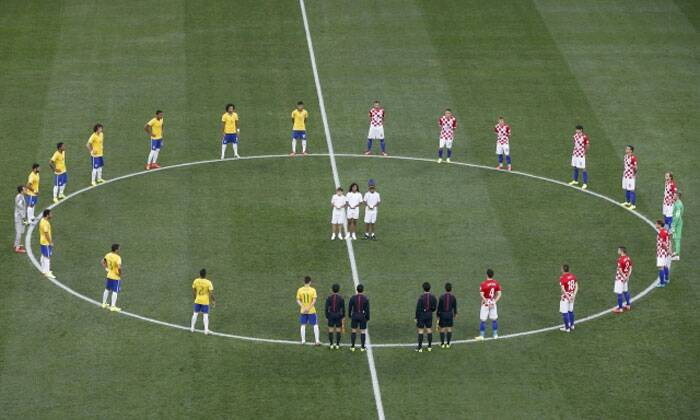 After a sizzling opening ceremony, the FIFA World Cup 2014 officially began with the releasing of three doves by the kids standing in the centre. Players and match officials stand on the pitch just before the start of the opening game between Brazil and Croatia at the Itaquerao Stadium in Sao Paulo. (Source: Reuters)