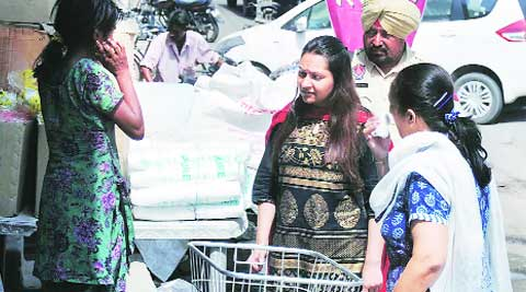 ADC Isha Kalia interacts with a beggar on Saturday. Gurmeet Singh