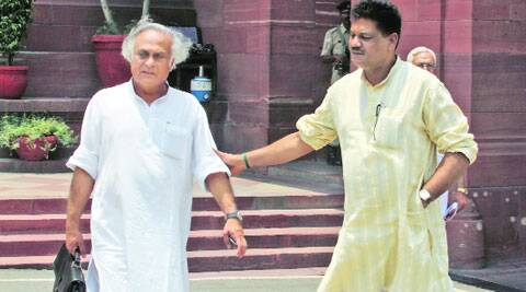 Congress MP Jairam Ramesh with BJP's Kirti Azad at Parliament House on Thursday. (Source: IE photo by Anil Sharma)