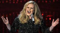 Adele wins damages over paparazzi photos ofson