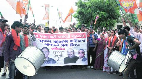 BJP workers celebrate the victory of the party in JMC polls, in Ahmedabad on Tuesday. (Bhavesh Ravat)