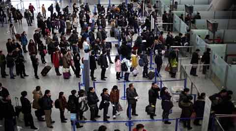 The Transportation Security Administration is requiring passengers at some overseas airports that offer U.S.-bound flights to power on their electronic devices. (Source: AP)