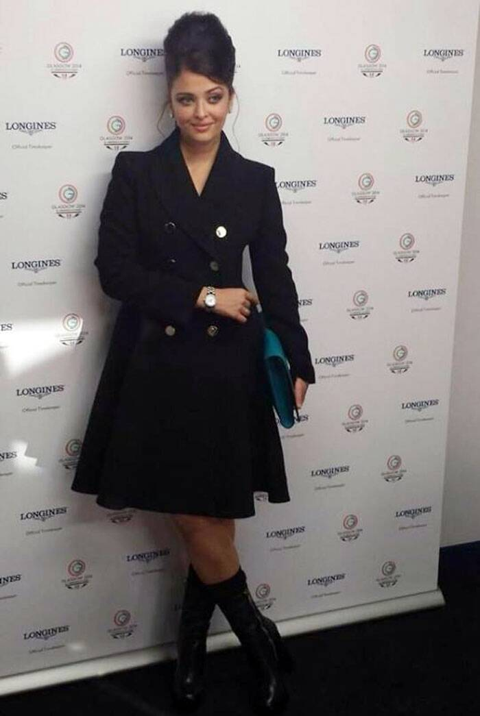 Aishwarya Rai Bachchan was the epitome of style in a black-buttoned trench coat with matching boots at Glasgow where the beauty was present for the Common Wealth Games as an ambassador for a designer watch brand. (Source: Facebook by AshSpicedotcom Fan Club)