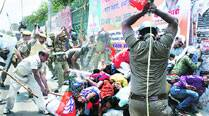 BJP youth workers fight pitched battle with police, severalinjured