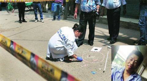 A CBI team collects forensic evidence from the spot where Akha Salouni (inset) was killed.