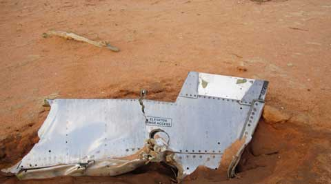 This photo provided on Friday, July 25, 2014, by the Burkina Faso Military shows a part of the plane at the crash site, in Mali. (Source: AP)