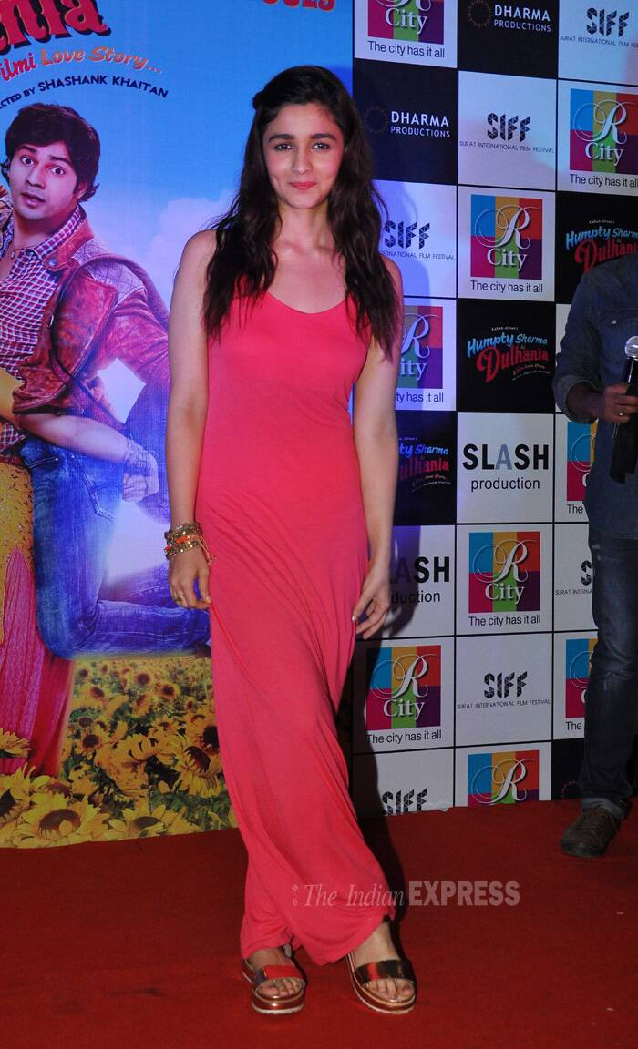 Alia Bhatt looks sassy in the bright reddish-pink maxi dress. A simple hair-do and minimal make-up finished off her look. However her choice of footwear scored low on our fashion metre. (Source: Varinder Chawla)