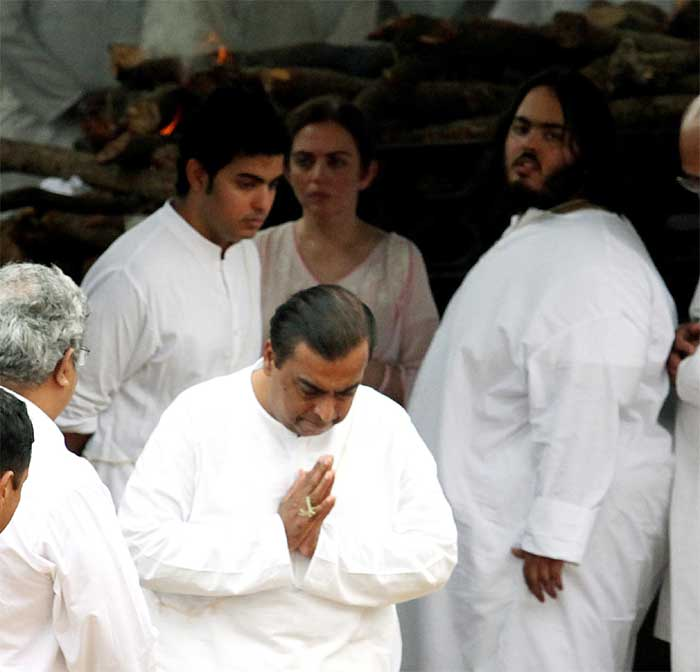 Industrialist Mukesh Ambani's wife Nita Ambani's father, who was a senior executive at Birla passed away in Mumbai on Wednesday. <br /> Seen here, are Mukesh Ambani, wife Nita, their two sons Akash and Anant at Nita Ambani's father's funeral. (Source: Express photo by Vasant Prabhu)