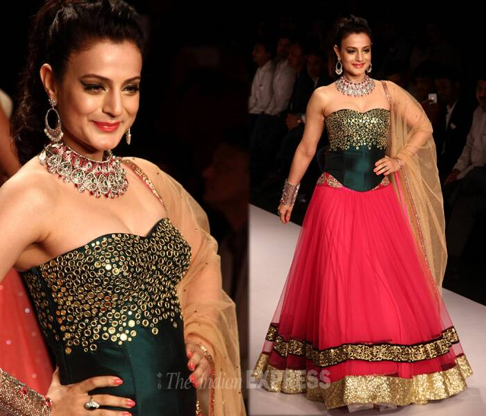 Ameesha was pretty in the hot-pink lehenga with a green corset bodice with metallic work. (Source: Varinder Chawla)