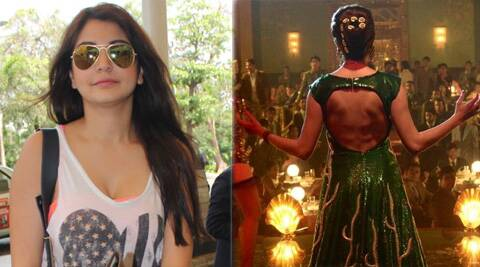 Anushka look opulent in a green sequin couture gown with flame like gold detailing. Take a look.