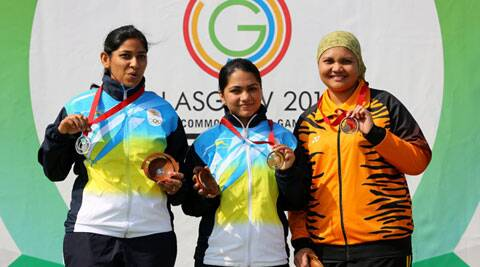 Apurvi Chandela (C) poses with teammate and silver medalist Ayonika Paul (L) and bronze medalist Malaysia's Nur Suryani Mohamed Taibi after women's 10m air rifle final. (Source: AP)
