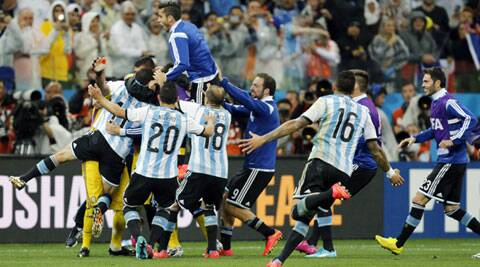 Argentina players celebrate after beating Netherlands 4-2 on penalties (Source: AP)