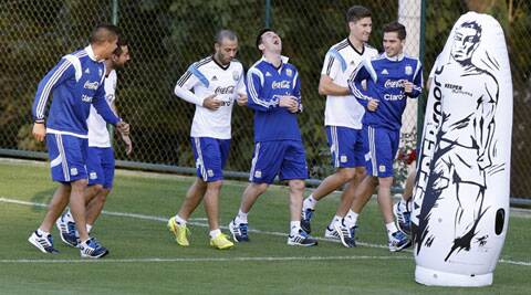 Argentina skipper Lionel Messi (C) shares a light moment during a training session. (Source: Reuters)