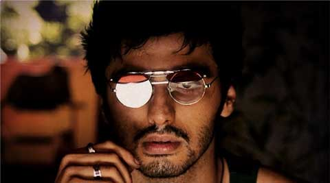 Wearing stylish glasses and ganjee, the 29-year-old actor  completed the rugged look by wearing a black thread around the neck in the Homi Adajania-directed film.