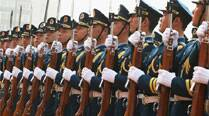 China lets 1st foreigners into army news briefing