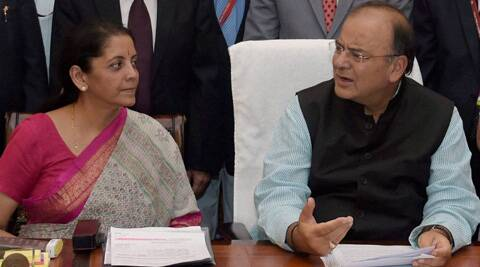 Finance Minister Arun Jaitley with MoS Nirmala Sitharaman while giving final touches to the Union Budget 2014-15 in New Delhi. (PTI)