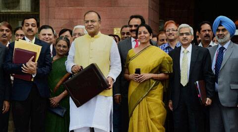 Union Finance Minister Arun Jaitley with MOS for Finance Nirmala Sitharaman and officials outside Finance Ministry. (Source: PTI)