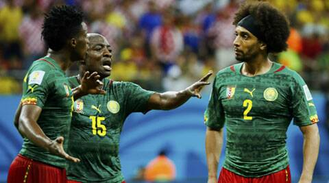 Defender Benoit Assou-Etoko argues with Achille Weboc and  Benjamin Moukandjo. Cameroon has a dismal showing at the World Cup as they lost all their games and managed to score only one goal. (Source: AP)