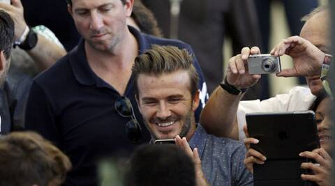 David Beckham takes pictures upon his arrival at the Maracana Stadium on Sunday. (Source: AP)