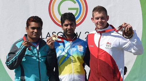 India's Abhinav Bindra (C), Abdullah Baki of Bangladesh (L) and Daniel Rivers of England (R) pose with their respective medals after the medal ceremony of the 10m Air Rifle event on Friday at Glasgow. (Source: PTI)
