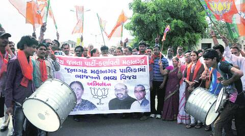 BJP workers celebrate the victory of the party in JMC polls, in Ahmedabad on Tuesday. Bhavesh Ravat