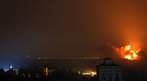 Flames spread across buildings after Israeli strikes in the Shijaiyah neighbourhood in Gaza City. (Source: AP)