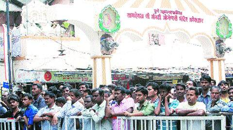 People outside Dagdusheth Halwai Ganesh Temple, which is adjacent to the blast site. (Source: Express photo byArul Horizon)
