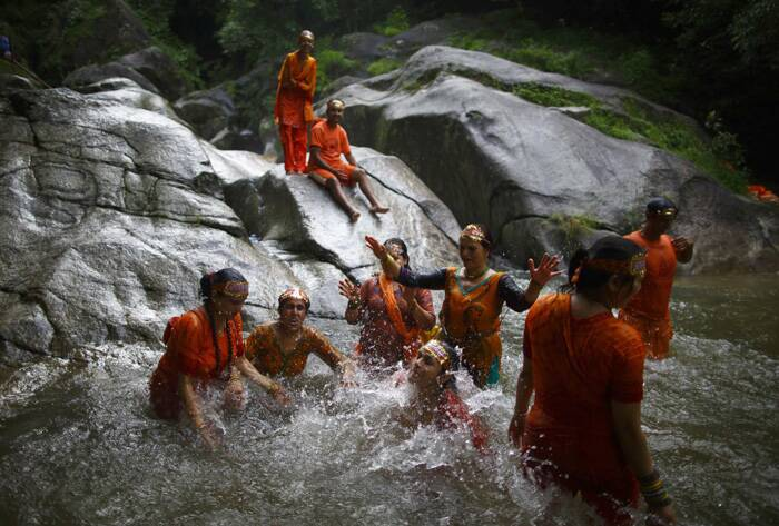 Devotees take a dip at the Bagmati River as they participate in the 'Bol Bom' (Say Shiva) pilgrimage in Kathmandu. (Source; Reuters)