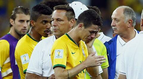 The Brazilian players in tears as they leave the field after their shocking 7-1 loss to Germany. (Source: Reuters)