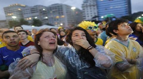 Brazil fans react to the astounding defeat to Germany on Tuesday. (Source: AP)