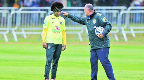 Brazil's Willian and coach Luis Felipe Scolari at a training session near Rio de Janeiro Friday. Source: Reuters