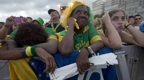 Despondent Brazil supporters watch Saturday's play-off game between the hosts and Netherlands. (Source: AP)