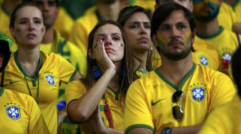 Brazil supporters react after the home team lost to Germany in the semifinals. (Source: Reuters)