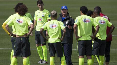 Brazil coach Luiz Felipe Scolari instructs players during a training session ahead of their semifinal clash against Germany on Tuesday. (Source: AP)
