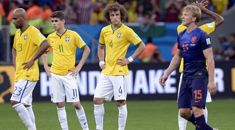 Brazil's David Luiz (C) and Brazil's Oscar stand dejected after the World Cup third-place match between Brazil and the Netherlands. (Source: AP)