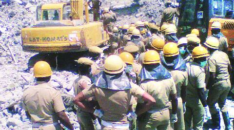 Rescue personnel at the site of the building collapse in Chennai.(Source: Express photo)