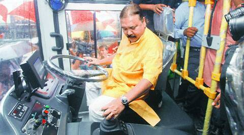 Transport Minister Madan Mitra in the driving seat during the launch of Jan Bus, in Kolkata on Wednesday. (Source: Express photo by Partha Paul)