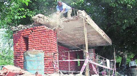 A bus queue shelter declared unsafe was earlier  demolished in Sector 15, Chandigarh. (Express Photo)
