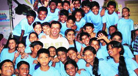 Madhur Bhandarkar poses with local NGO children at the launch of Calendar Girls