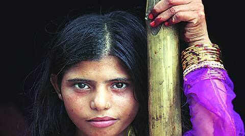 Khushnuma sports the bangles she received from her father Fahimmudin on Eid at Joula relief camp in Muzaffarnagar, Tuesday. Source: Oinam Anand