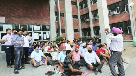 Striking teachers at CCET on Thursday. (Source: Express photo by Jaipal Singh)