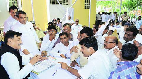 Chavan interacts with villagers and Congressmen during a party meeting in Karad on Sunday. (Source: PTI)