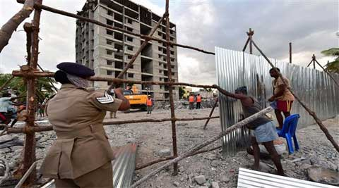Tamil Nadu government authorities sealing the building collapse site after completion of the rescue works. (Source: PTI)