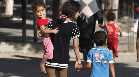 Palestinians flee their homes in the Shajaiyeh neighborhood of Gaza City. (Source: AP)