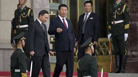 Chinese President Xi Jinping walks near soldiers as he attends a welcome ceremony for Myanmar President Thein Sein in Beijing, China. (Source: AP)