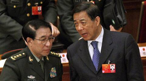 Xu Caihou, bottom left, deputy chairman of the CPC Central Military Commission, which controls China's military, chats with Chongqing party secretary Bo Xilai, bottom right, after a plenary session of the National People's Congress at the Great Hall of the People in Beijing, China. (Source: AP)