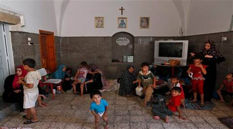 Palestinians start their day inside the St. Porphyrios Church in Gaza City. (Source: AP)