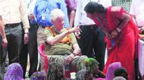 Bill Clinton interacts with kids, women in UP village