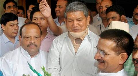 Uttarakhand Chief Minister Harish Rawat is greeted on his win in the bypoll to Dharchula Assembly seat, in Dehradun on Friday. (PTI Photo)